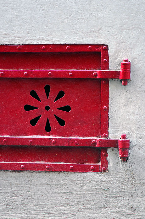 The red door in the white wall
