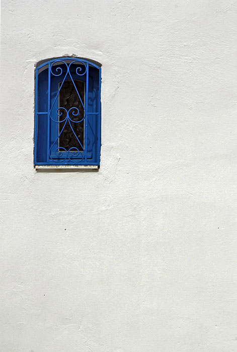 The blue window in the white wall