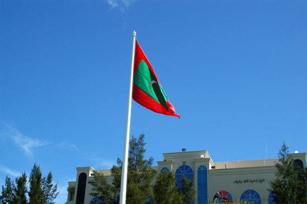 Flag of the Republic of the Maldives flying over Jumhooree Maidan, Republic Square