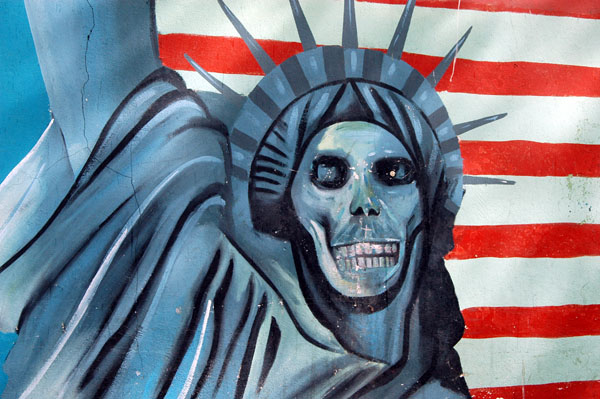 Famous mural of Statue of Liberty with a skull face in front of an American flag, former US Embassy, Tehran