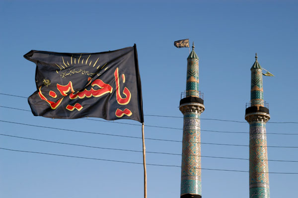 Ya-Hussein on a flag with the Jameh Mosque minarets