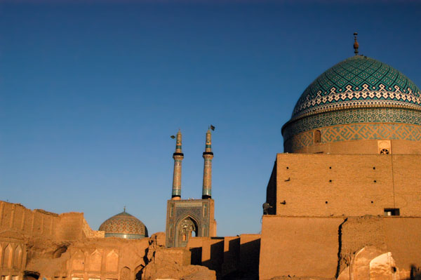 Jameh mosque in the morning from Silk Road Hotel with dome of Bogheh-ye Seyed Roknaddin