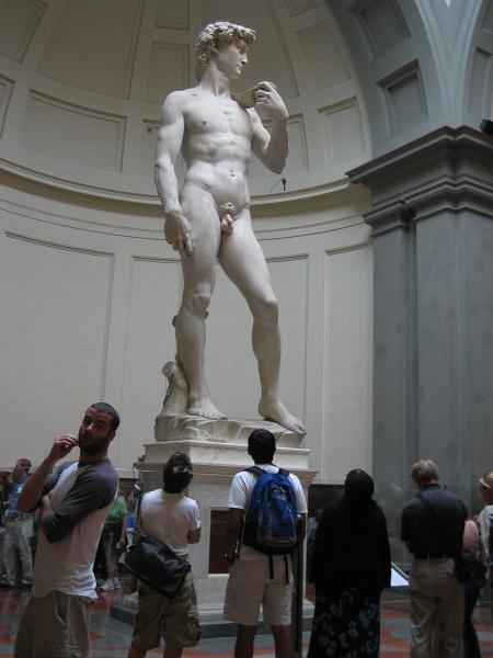 Michelangelos David.  Light on visitors right hand mirrors Davids left.