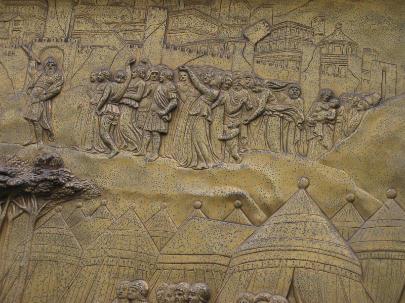 Celebrating fall of Jericho.  Distant figures in low-relief, from previous panel