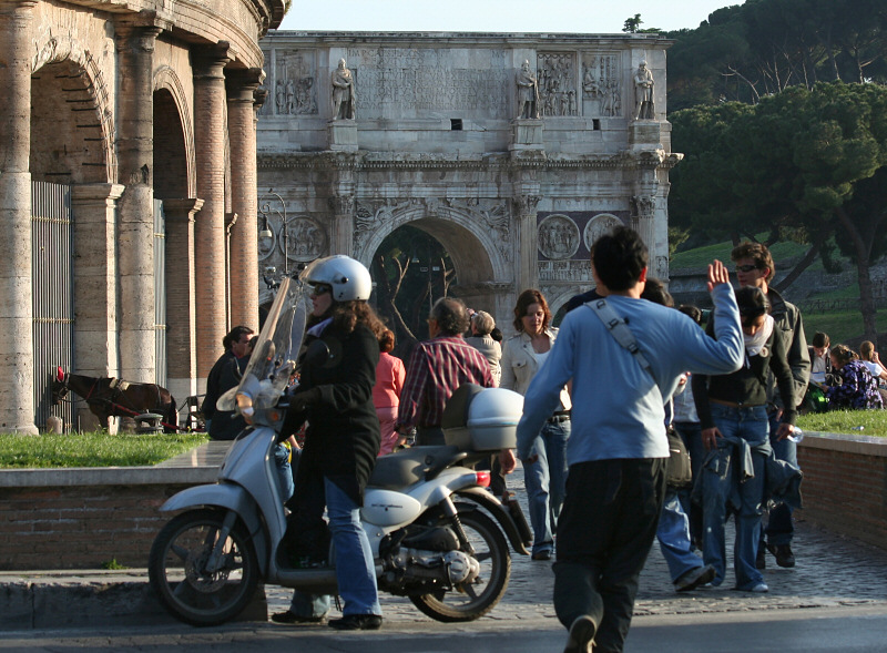 Arch of Constantine overlooks a lively scene.
