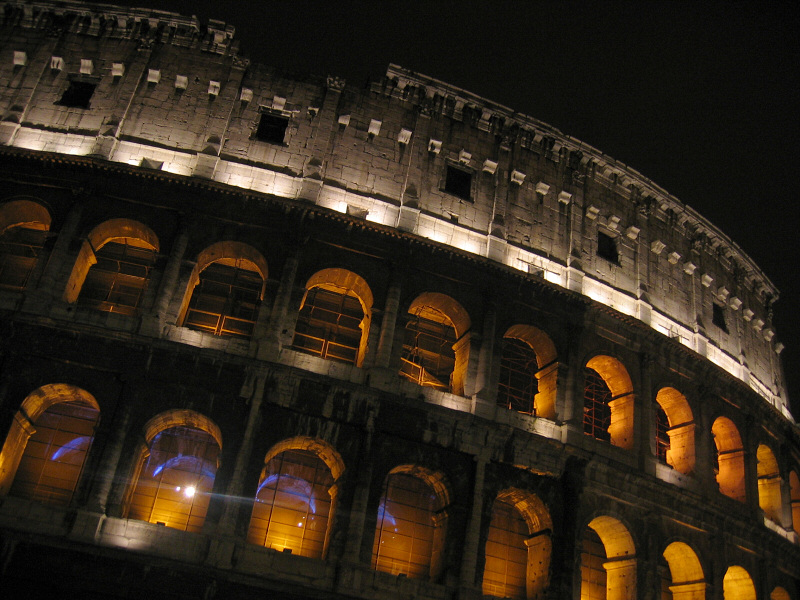 Colosseum at night.  Windows shuttered (!)