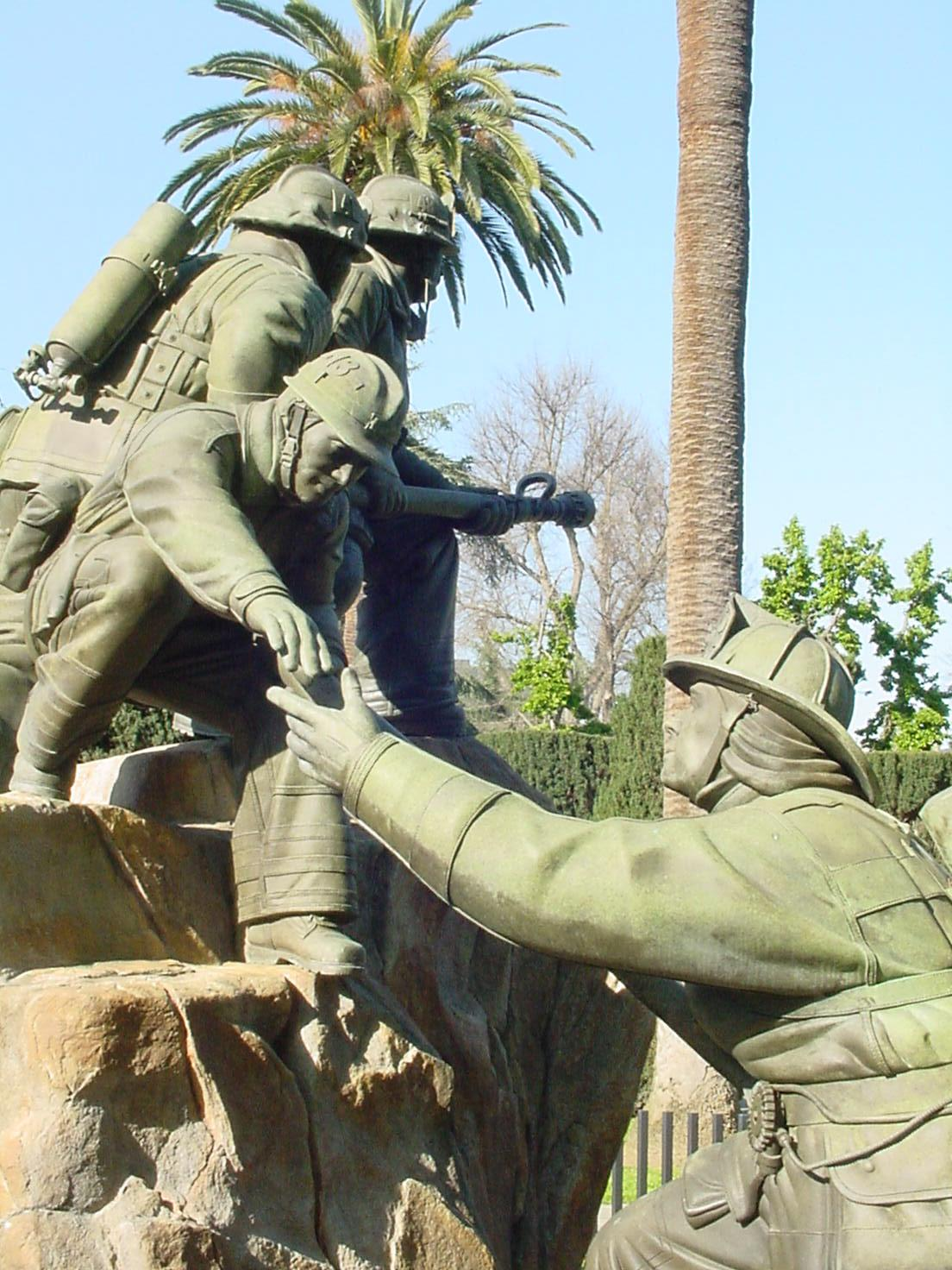 A close-up of the Firefighter Memorial