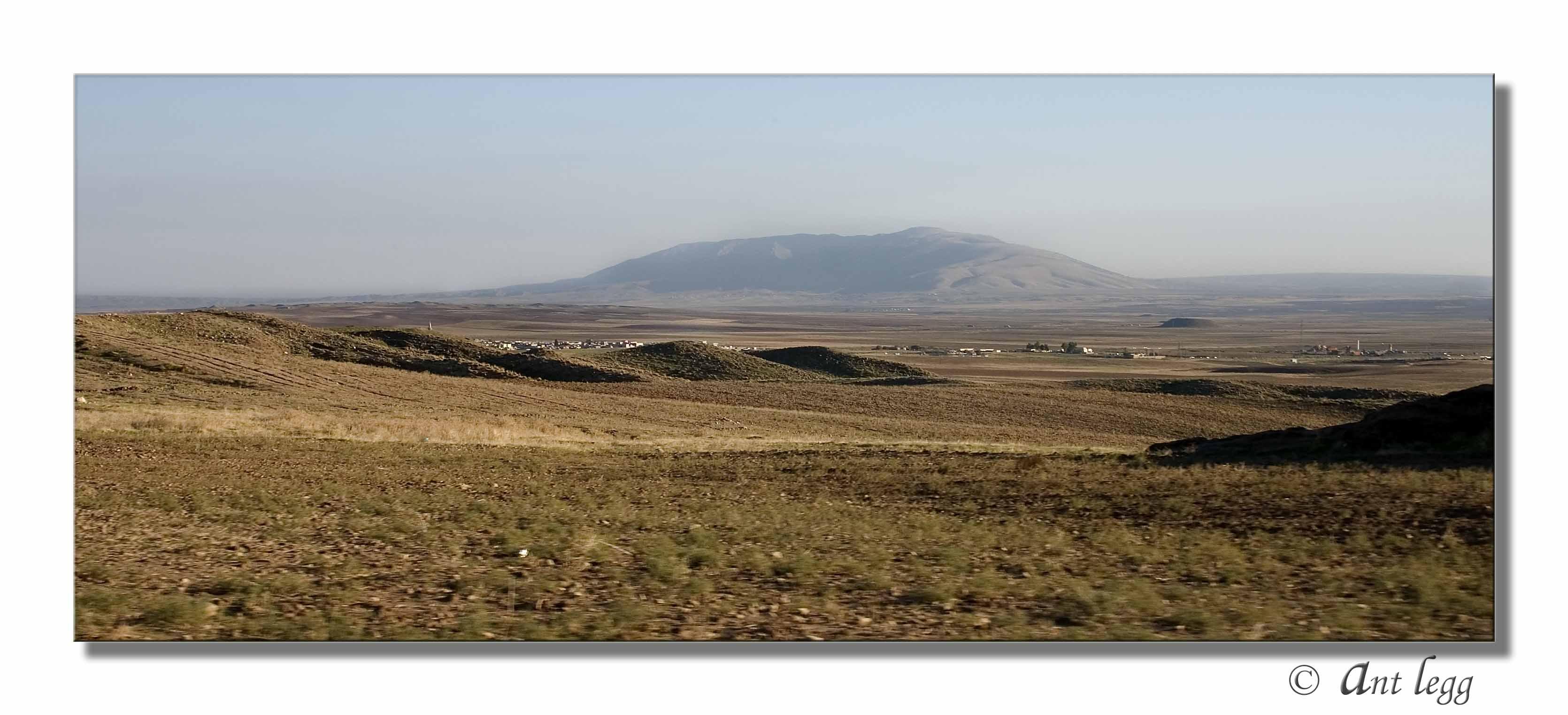 Village behind the hills