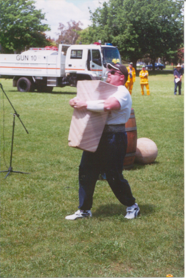 Carrying the 170kg Husafel Stone at the Ainslie School fete 2000