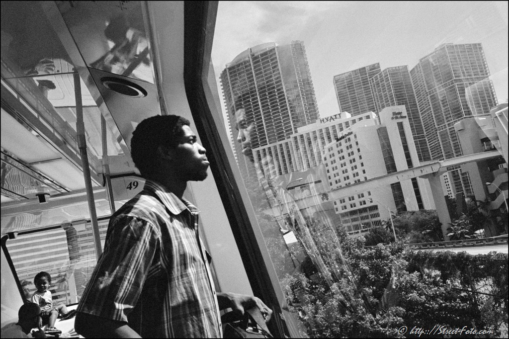 Man standing by the window in Metromover car, Downtown Miami, Florida, USA, 2011. Street Photography of Miami, San Francisco and Key West by Emir Shabashvili, see http://street-foto.com, http://miamistreetphoto.com, http://miamistreetphotography.com or http://miamistreetphotographer.com