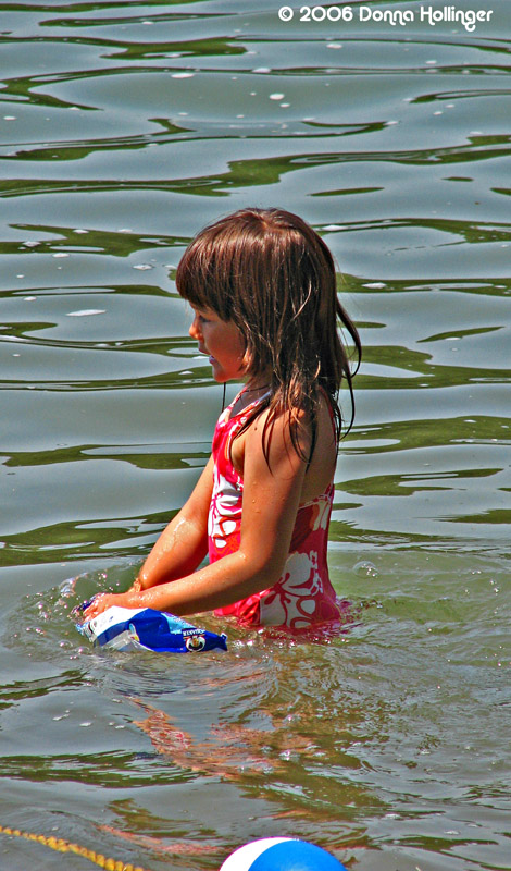 Little girl in Walden Pond