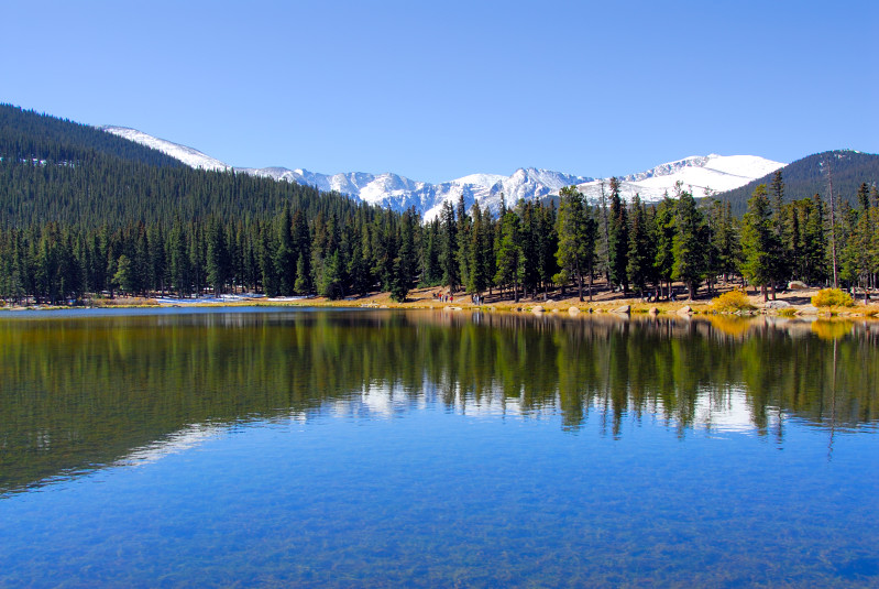 Echo Lake assumes a tranquil scene in front of the snowy Rocky Mountains