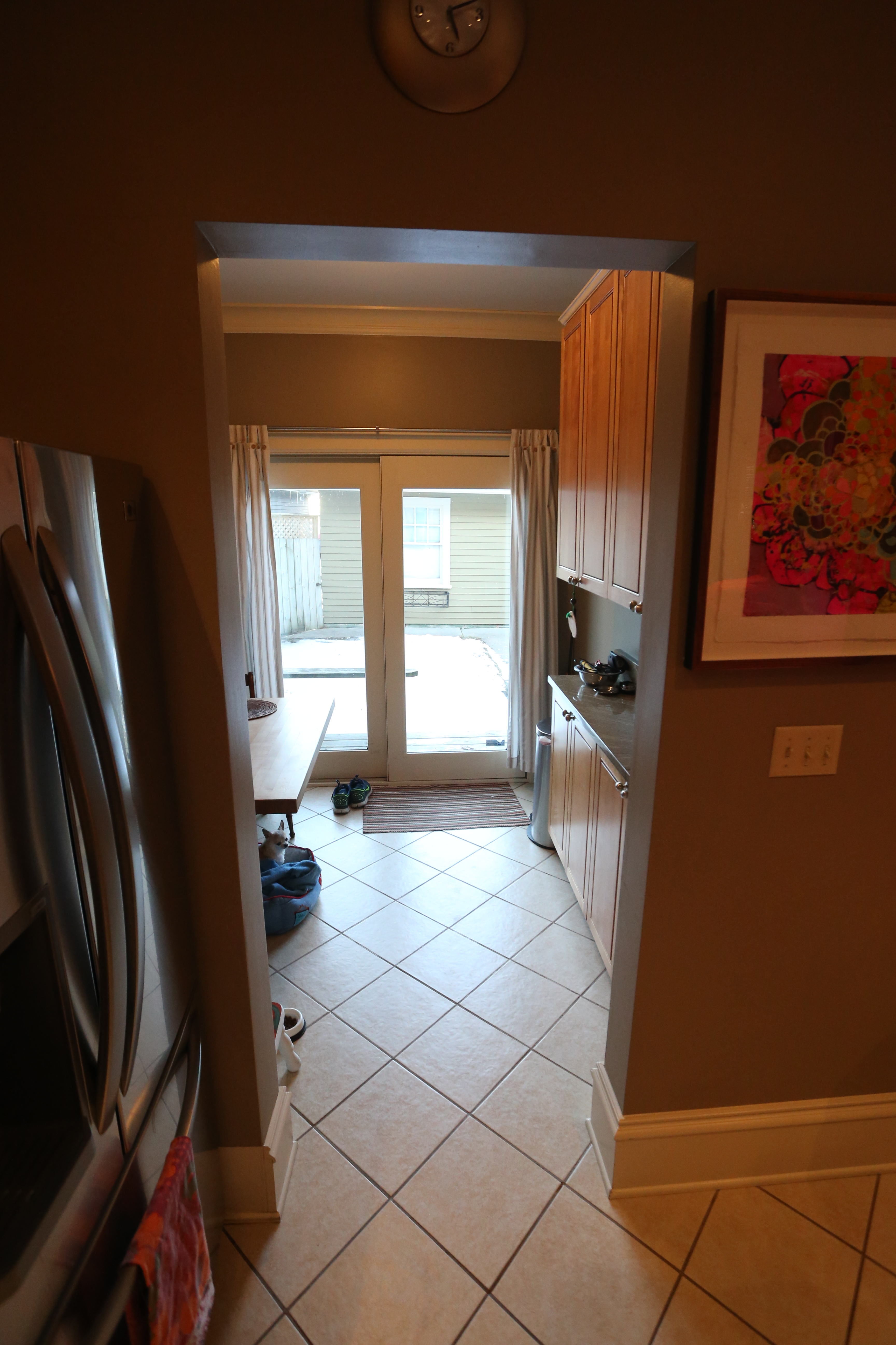 Kitchen looking into small patio room