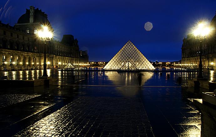 The Louvre Pyramid On a Rainy Night