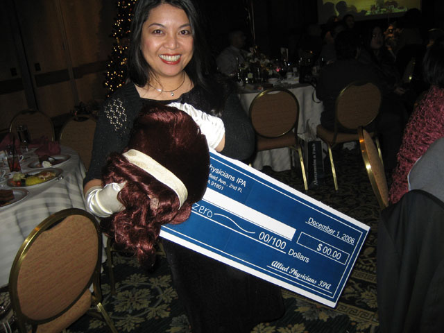 cecile holding the big check