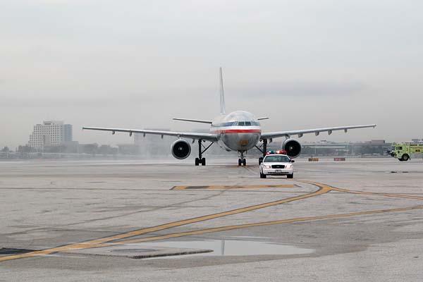 Flight 971 under Miami-Dade Police escort to the gate photo #2115