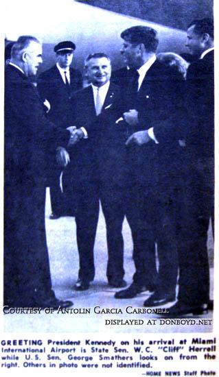1963 - President John F. Kennedy greeting State Senator W.C.Cliff Herrell with U. S. Senator George Smathers looking on at MIA