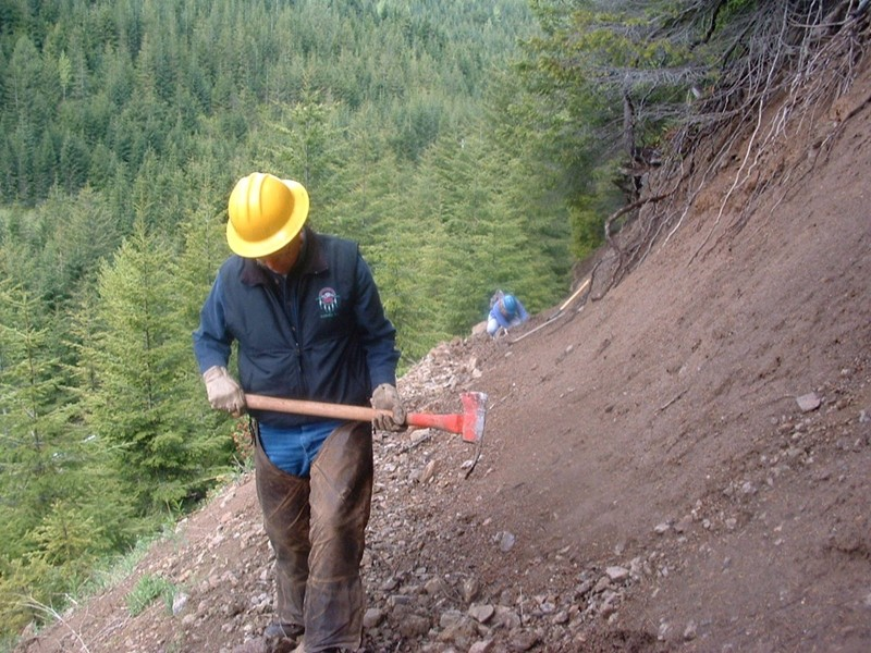 Joe Russell clearing slide area trail to Norse Peak from Half Camp