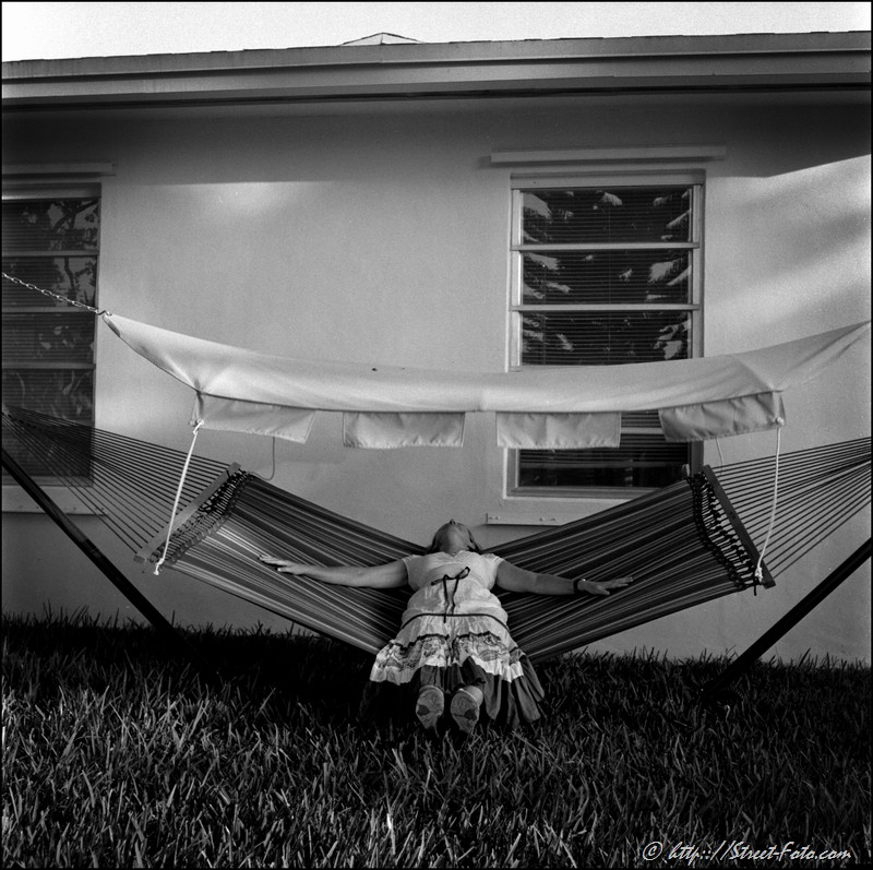 Woman sleeping in a hammock in the residential area of Kendall, Miami, USA, 2010. Street Photography of Miami, San Francisco and Key West by Emir Shabashvili, see http://street-foto.com, http://miamistreetphoto.com, http://miamistreetphotography.com or http://miamistreetphotographer.com