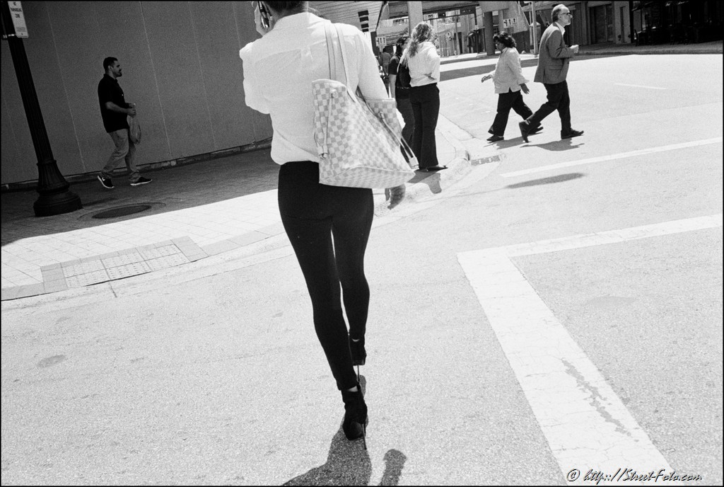 Woman walking on high heels in Downtown Miami, Florida, USA, 2011. Street Photography of Miami, San Francisco and Key West by Emir Shabashvili, see http://street-foto.com, http://miamistreetphoto.com, http://miamistreetphotography.com or http://miamistreetphotographer.com