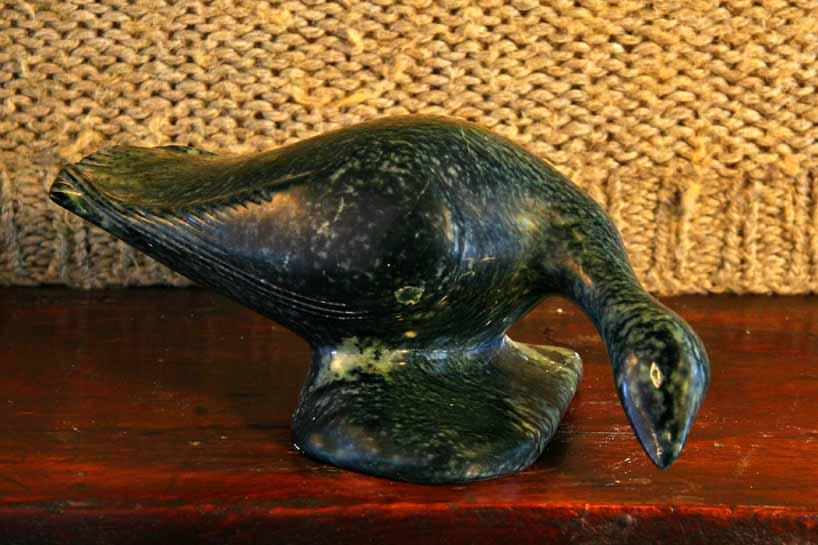 2-bird eating -sepentine