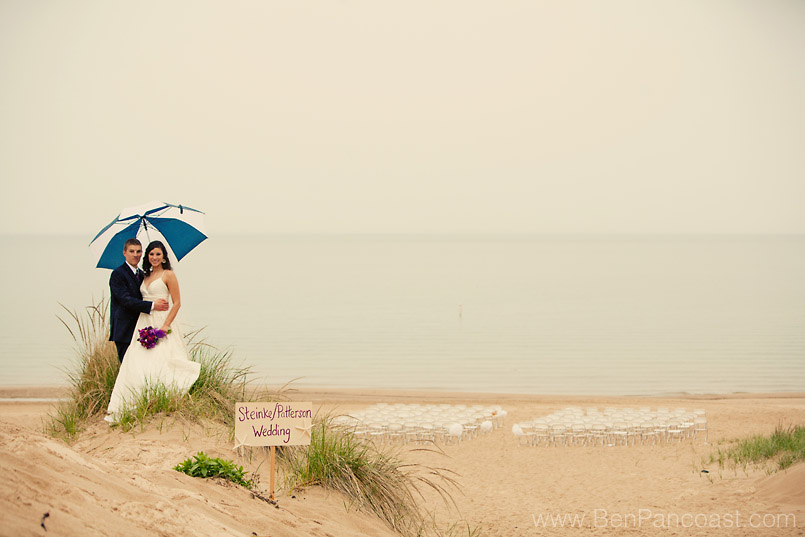 A beach wedding in the rain at Lake Bluff Inn and Suites in South Haven Michigan.