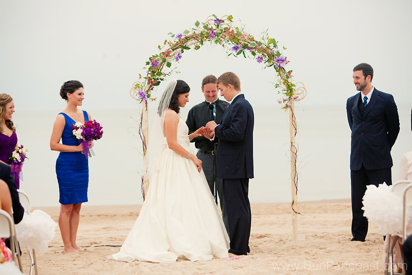 A beach wedding in the rain in South Haven Michigan.