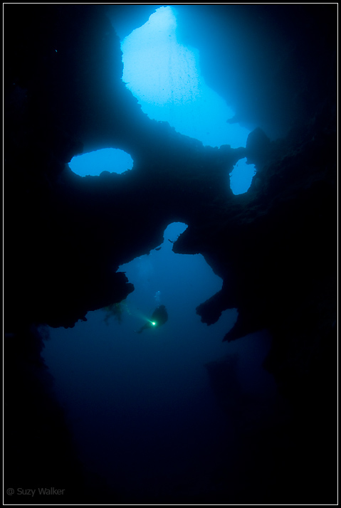 Phantom cave - one diver with torch