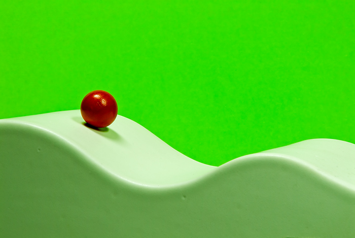 The white path of the red ball