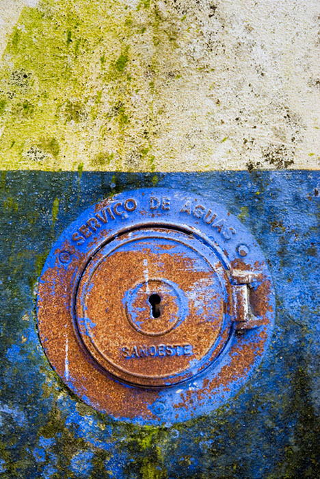 Rusty water service in blue and white