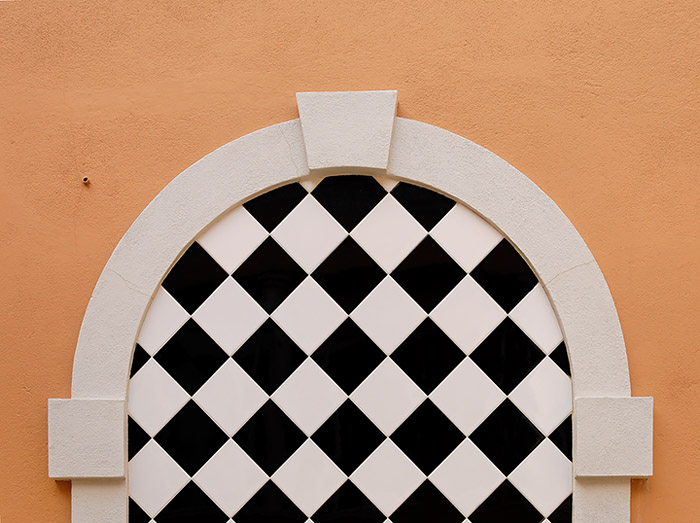 Arch with black and white tiles