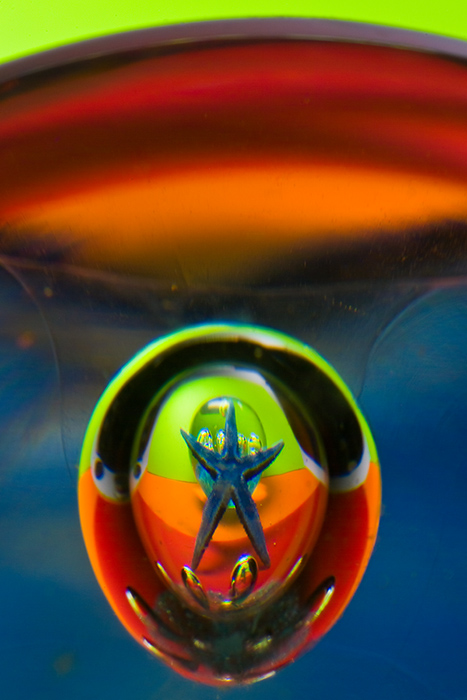 The blue star in the drop of glass