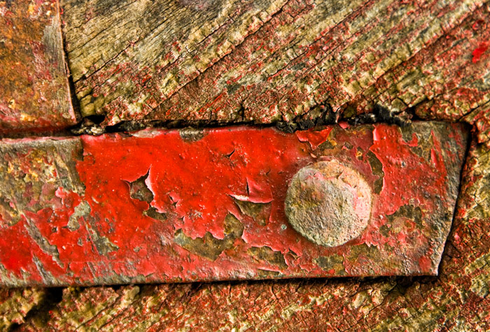 Wood and metal painted in red