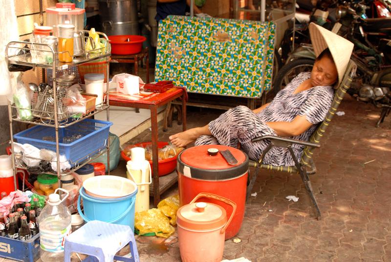 Street vendor taking a nap, Saigon