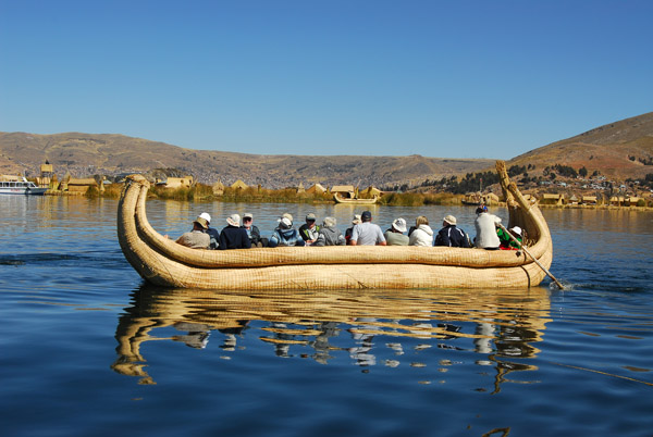 Reed boat with tourists, Lake Titicaca