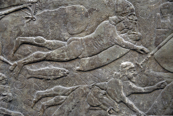 Wall panel depicting soldiers crossing a river floating on inflated animal skins, Assyrian ca 860 BC, Nimrud northwest palace