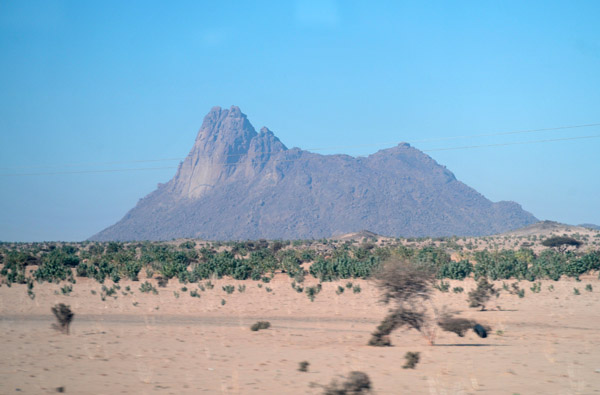 Eastern face of a thousand foot peak rising out of the desert north of the village of Tahamyam