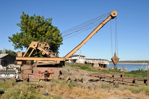 Crane near the Sudan Railways depot and riverboats, Karima