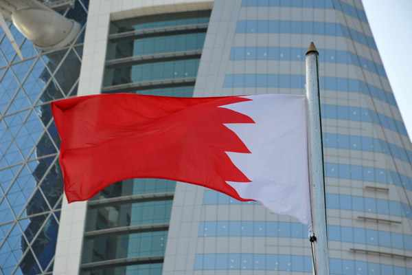 Flag of Bahrain in front of the Bahrain World Trade Centre