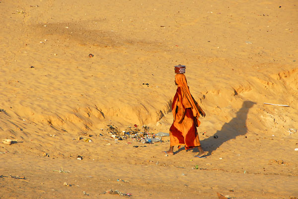 Woman in a colorful dress against the desert