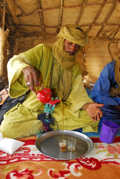 Tuareg pouring tea for us
