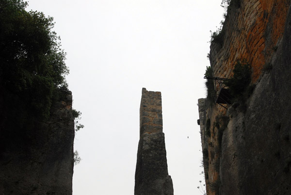 A defensive ditch was cut out of the solid rock along the eastern edge of the castle with one pillar left for the drawbridge