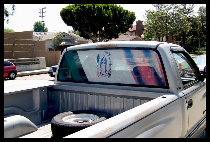Virgen on the truck window.