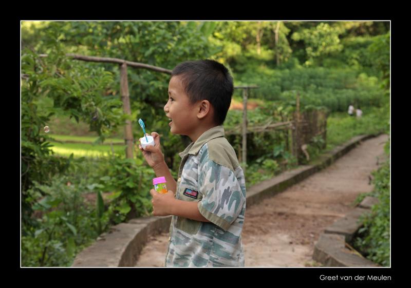 7399 Vietnam,  boy blowing bubbles