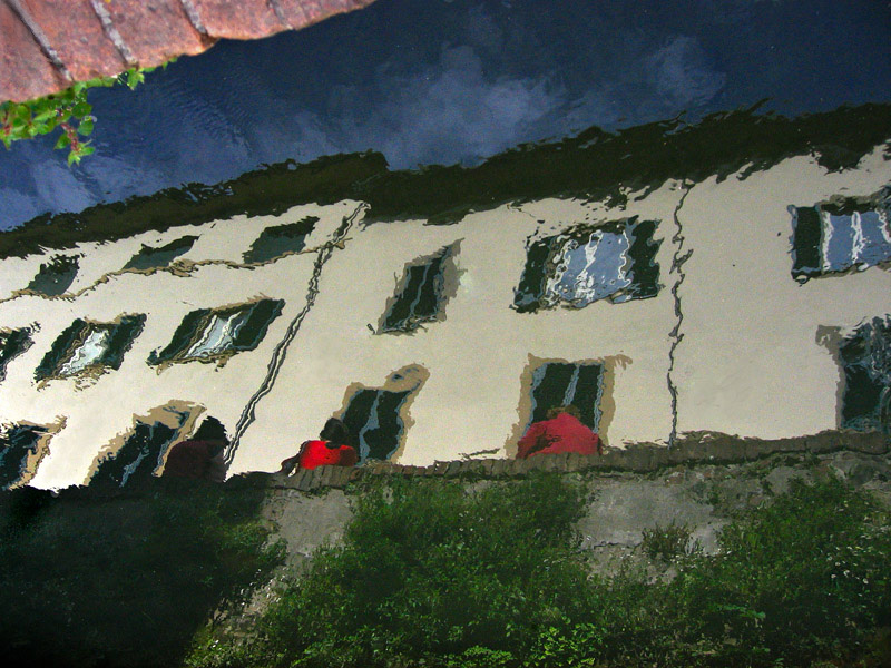 Reflection in Luccas Canal, of two in red  (no Photoshop tricks)