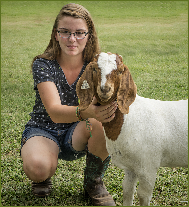 A Girl and Her Pet Goat