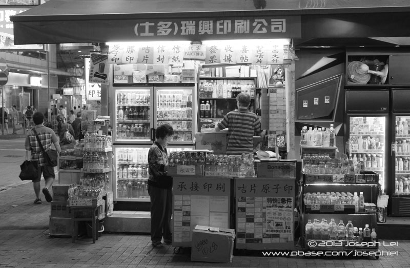 A stand that sells beverages and ink stamps