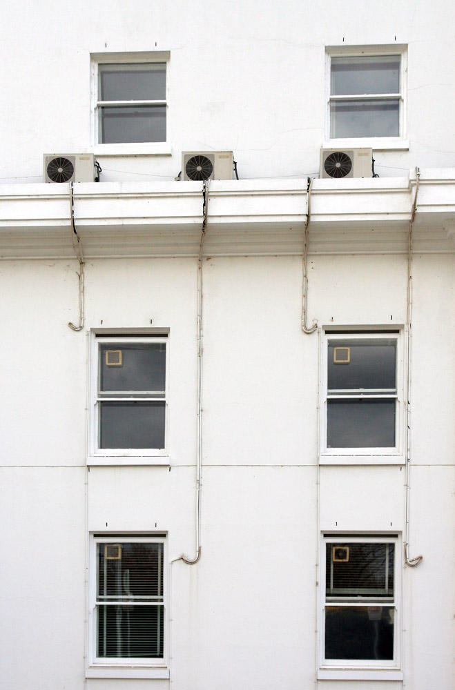 Windows in a White Wall