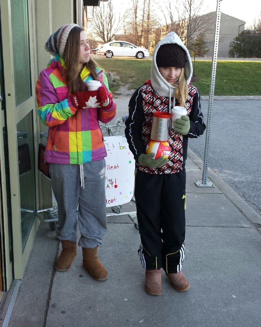 A photo of Amy and Jenna from the Durham Attack 13U Heat volleyball team during the teams' fundraising effort at the LCBO Brocks Rd. and Hwy. 2 location in Pickering.
