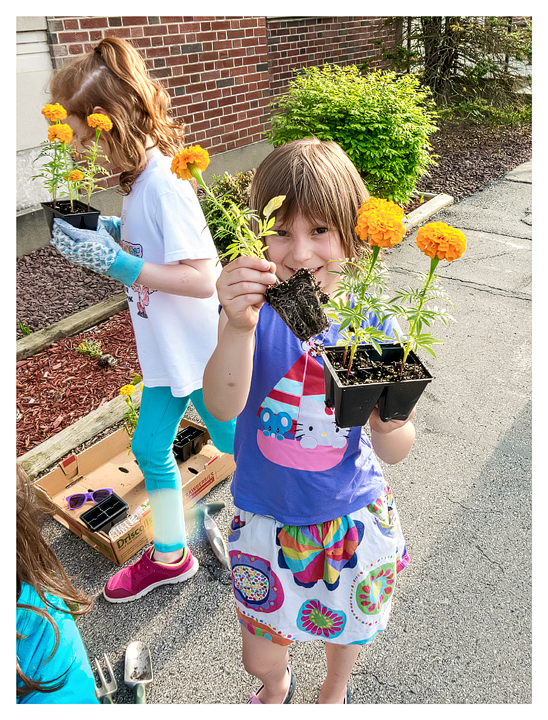 Planting with her Daisy troop